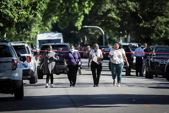 Four investigators with Cook County Medical Examiner's office walk away from the home in the 6200 block of South Morgan, Tuesday, June 15, 2021, in Chicago.