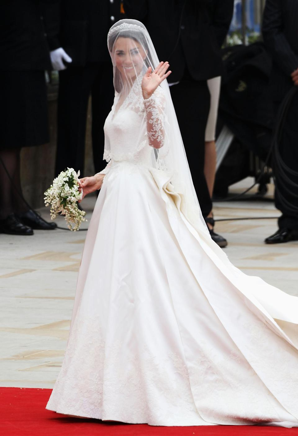 <p>For her big day, the Duchess of Cambridge opted for a lace gown designed by Alexander McQueen's Sarah Burton. The floow-sweeping number incorporated lace, floral motifs and a seriously impressive train. It reportedly cost £250,000 and sparked a mass number of copies. <em>[Photo: Getty]</em> </p>