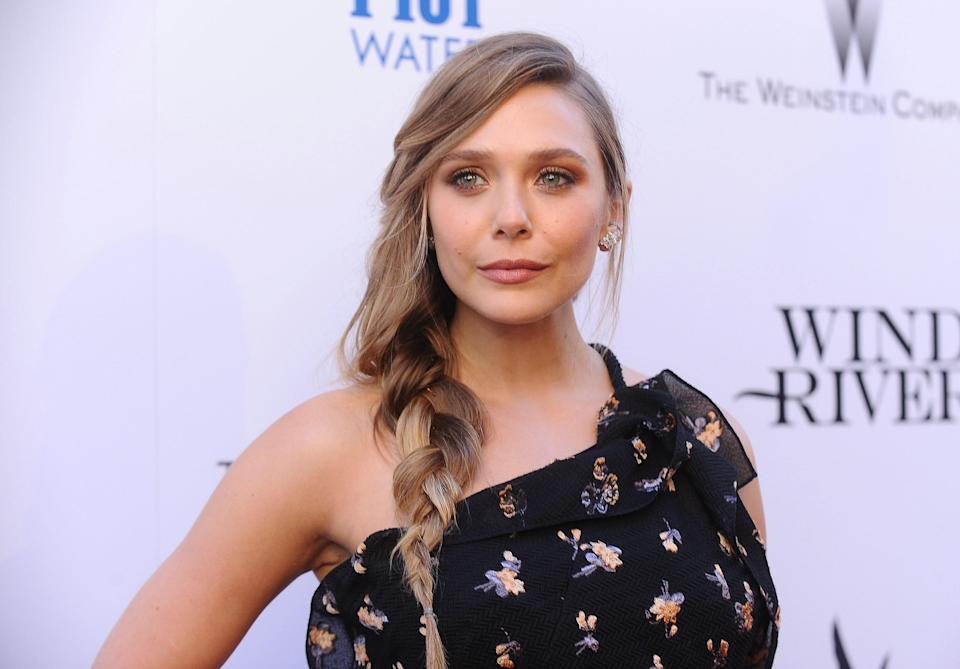 Elizabeth Olsen's mussed side braid is a work of casual, beautiful art. To replicate it, part your hair deep to one side, and then start braiding just below your jawline. Tug on a few sections to loosen them, and this look can go anywhere.