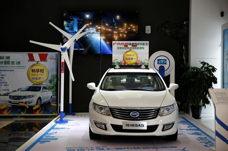 A Trumpchi GA5 hybrid electric car is displayed at an electric car dealership in Shanghai