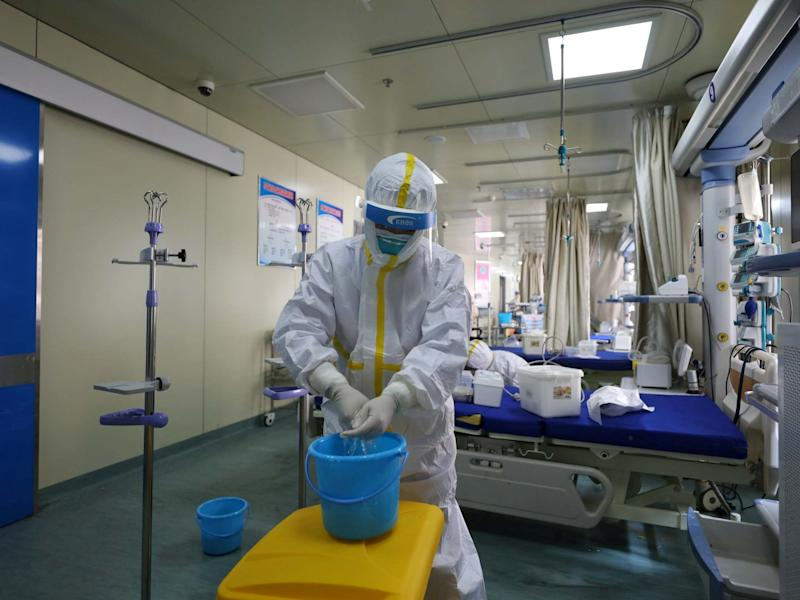 Medical workers in protective suits disinfect an intensive care unit (ICU) ward of Union Jiangbei Hospital in Wuhan: REUTERS