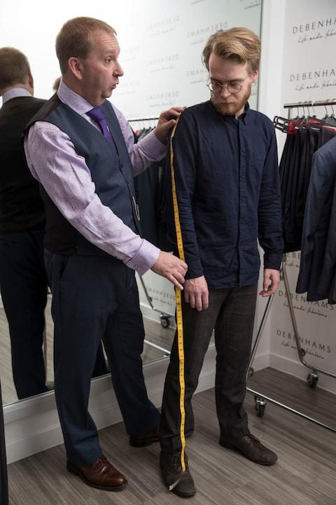 Tom Ough being measured up for a bespoke suit at Debenhams - Credit: Heathcliff O'Malley