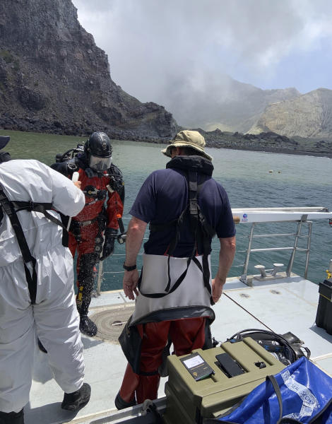 Police divers prepare to search the waters near White Island off the coast of Whakatane, New Zealand, Saturday Dec.14, 2019. A team of nine from the Police National Dive Squad resumed their search early Saturday for a body seen in the water following Monday's volcanic eruption. (New Zealand Police via AP)