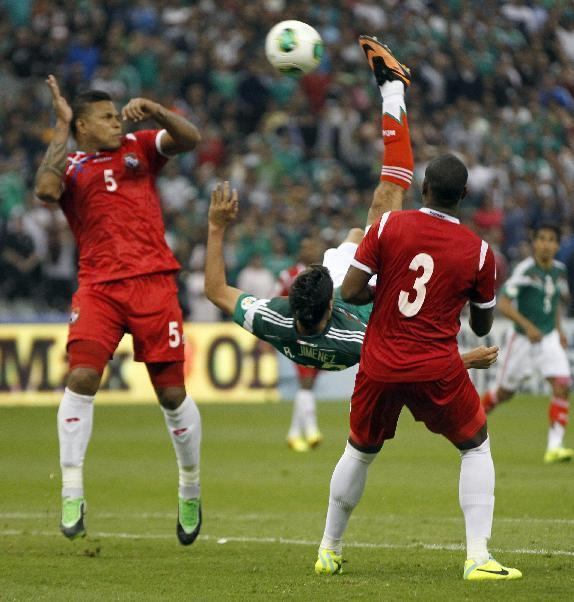 Mexico's Raul Jimenez, center, shoots to score the winning goal against Panama at a 2014 World Cup qualifying match, in Mexico City, Friday, Oct. 11, 2013. Mexico defeated Panama 2-1. (AP Photo/Eduardo Verdugo)