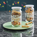 """<p>A charming little place to put those pet treats. These delightful jars come personalised with your pet's name.</p><p>£8 <a href=""""http://www.notonthehighstreet.com/jgartwork/product/personalised-pet-lover-treat-storage-jar"""" rel=""""nofollow noopener"""" target=""""_blank"""" data-ylk=""""slk:Not On The High Street"""" class=""""link rapid-noclick-resp"""">Not On The High Street</a></p>"""