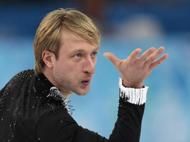 Evgeny Plyushchenko of Russia competes in the men's team short program figure skating competition at the Iceberg Skating Palace during the 2014 Winter Olympics, Thursday, Feb. 6, 2014, in Sochi, Russia. (AP Photo/Ivan Sekretarev)