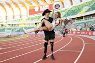 """<p>Two-time Paralympian <a href=""""http://www.popsugar.com/celebrity/tara-davis-hunter-woodhall-engagement-photos-48522481"""" class=""""link rapid-noclick-resp"""" rel=""""nofollow noopener"""" target=""""_blank"""" data-ylk=""""slk:Hunter Woodhall and Olympian Tara Davis are engaged"""">Hunter Woodhall and Olympian Tara Davis are engaged</a>! The track and field superstars shared the news just a few months after they stole America's hearts at the US Olympic Trials, where Woodhall famously <a href=""""http://www.popsugar.com/fitness/tara-davis-qualifies-for-2021-tokyo-olympics-48395773"""" class=""""link rapid-noclick-resp"""" rel=""""nofollow noopener"""" target=""""_blank"""" data-ylk=""""slk:scooped Davis up in his arms after she qualified for Tokyo"""">scooped Davis up in his arms after she qualified for Tokyo</a>. Here's what you and your partner will need to nail the look.</p> <p><strong>For Hunter:</strong></p> <ul> <li><span>Kangaroo Cowboy Hat</span> ($18)</li> <li><span>Fruit of the Loom Short Sleeve Black Crew T-Shirts</span> ($19)</li> <li><span>Nike Flex Stride 7"""" Brief Running Shorts</span> ($50)</li> </ul> <p><strong>For Tara:</strong></p> <ul> <li><span>Queue Essentials Western Style Pinch Front Cowgirl Straw Hat</span> ($41) </li> <li><span>Dragon Fit Sleeveless Yoga Top</span> ($18)</li> <li><span>Always Workout Yoga Shorts</span> ($13-$14)</li> <li><span>Vimisaoi Mid-Calf Cowboy Boots</span> ($39)</li> <li><span>Decades Awards Place Medal</span> ($8)</li> <li><span>Uelfbaby American Handheld Stick Flags</span> ($9)</li> </ul>"""