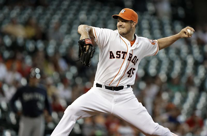 Houston Astros' Erik Bedard delivers a pitch against the Seattle Mariners in the sixth inning of a baseball game Saturday, July 20, 2013, in Houston. (AP Photo/Pat Sullivan)
