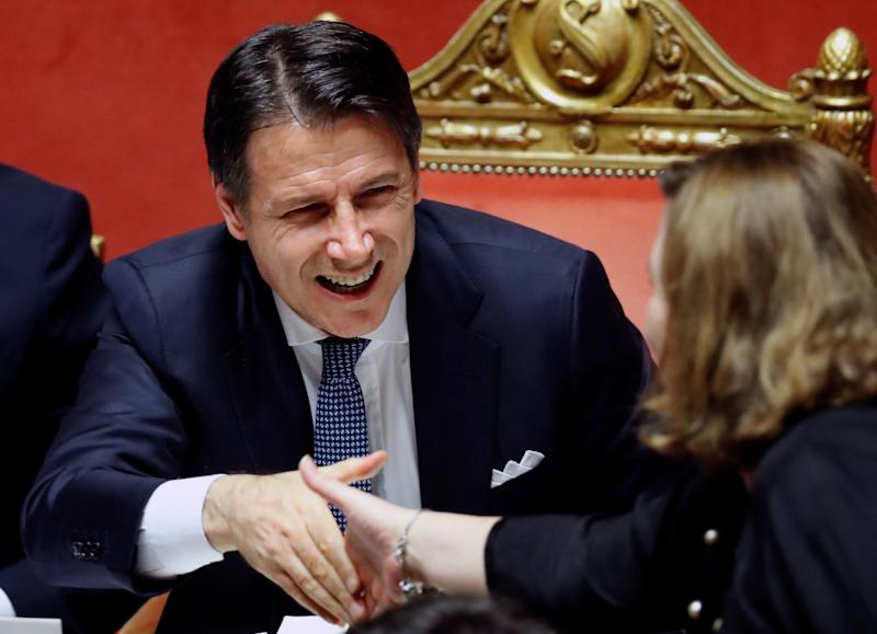 Italian Prime Minister Giuseppe Conte is greeted after his speech ahead of a confidence vote in Rome, Italy September 10, 2019 REUTERS/Remo Casilli