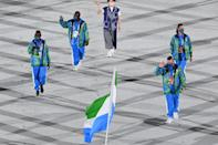 <p>Sierra Leone paid homage to the flag in blue, green and white patterned sweatsuits. </p>