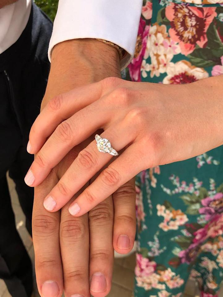 """<p><a href=""""https://www.popsugar.com/fashion/princess-beatrice-engagement-ring-46682235"""" class=""""ga-track"""" data-ga-category=""""Related"""" data-ga-label=""""http://www.popsugar.com/fashion/princess-beatrice-engagement-ring-46682235"""" data-ga-action=""""In-Line Links"""">Beatrice's engagement ring</a> was designed by her fiancé and created by London-based jeweler Shaun Leane. It features a larger round diamond in the center, flanked by two baguette diamonds on either side and is reportedly worth $123,000. </p>"""