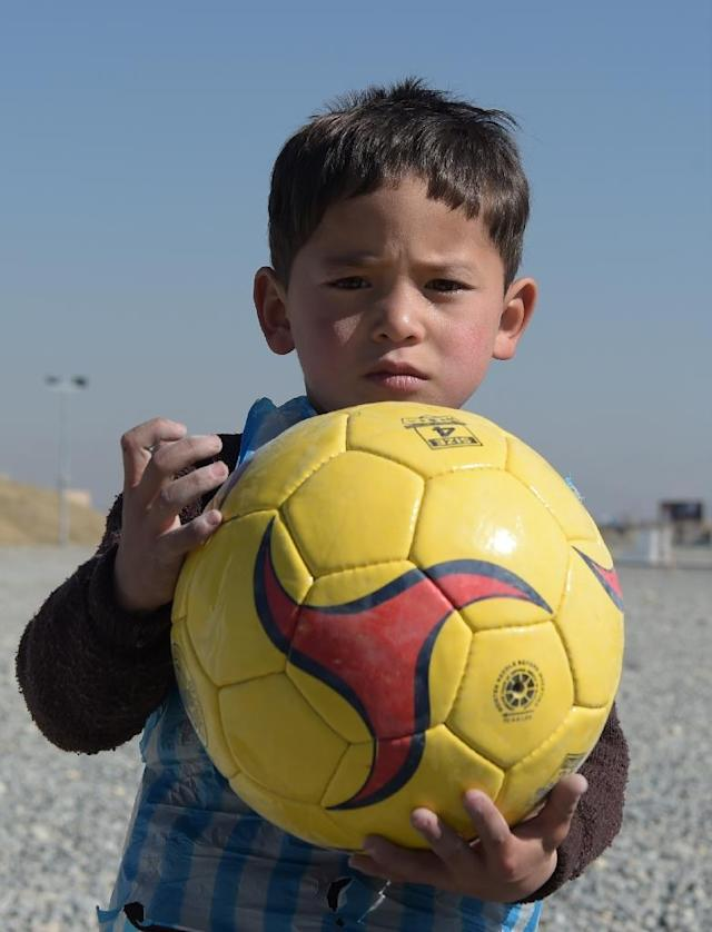 Afghan boy Murtaza Ahmadi is hoping to meet his idol Lionel Messi (AFP Photo/Shah Marai)