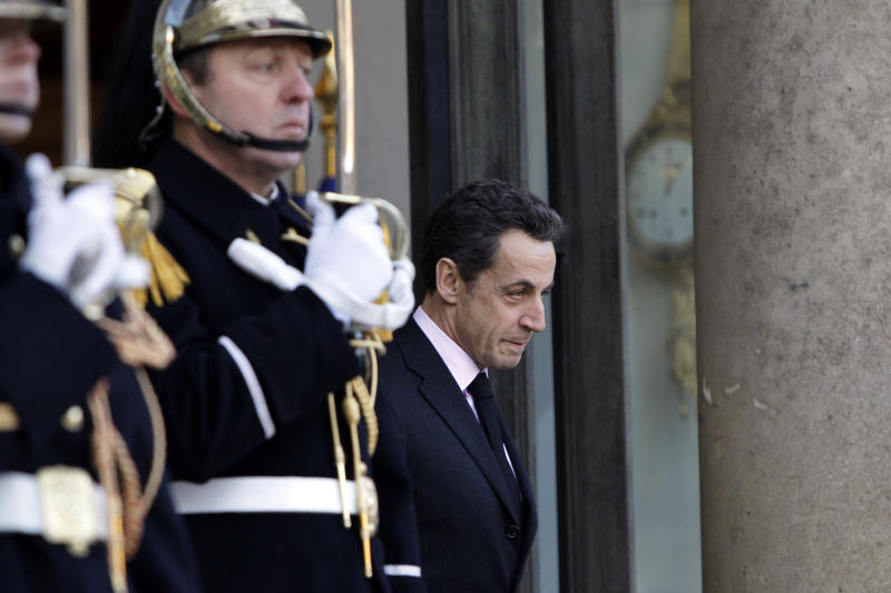 French President Nicolas Sarkozy waits for Lebanese Prime Minister Saad Hariri at the Elysee Palace in Paris, France, Tuesday, Nov. 30, 2010. (AP Photo/Francois Mori)