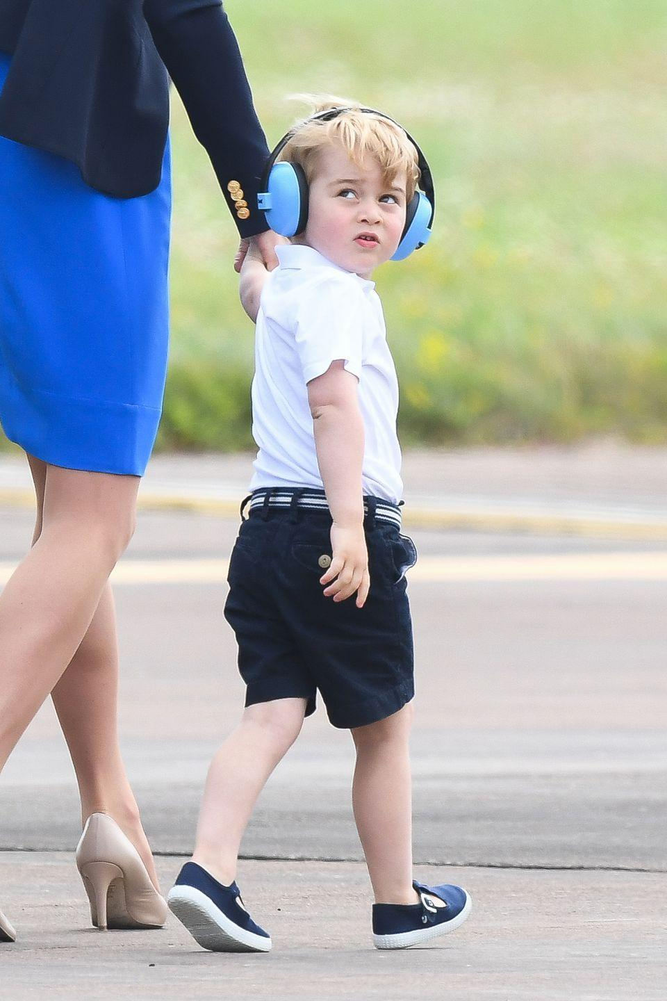 <p>Prince George seems extremely impressed by the planes...</p>