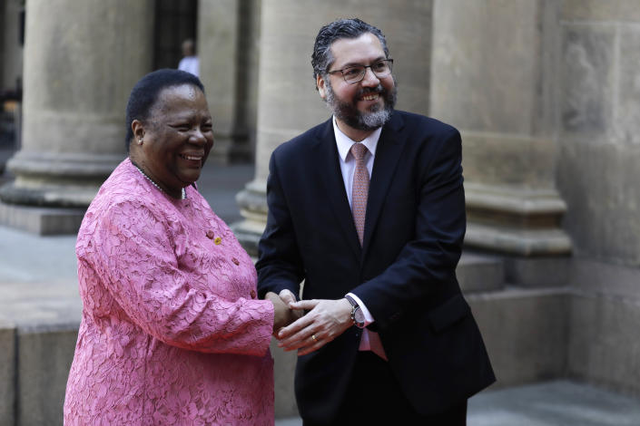South Africa's Minister of International Relations and Cooperation Naledi Pandor and Brazil's Foreign Minister Ernesto Araujo pose for photograpghers as she arrives to take part in a photo session of BRICS representatives, in Rio de Janeiro, Brazil, Friday, July 26, 2019. BRICS is a grouping of major emerging economies encompassing Brazil, Russia, India, China and South Africa. The delegations from the BRICS nations began meeting Friday to pave the way for a summit in November. (AP Photo/Leo Correa)