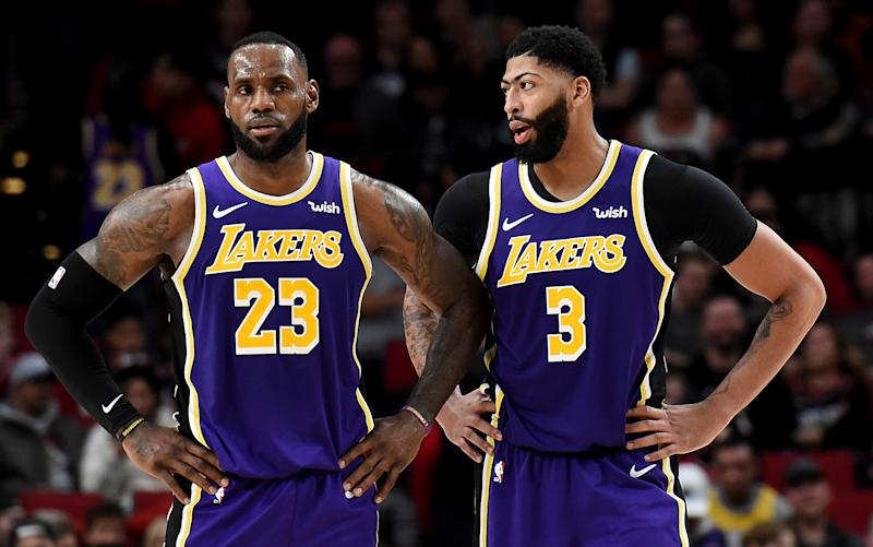 LeBron James and Anthony Davis have transformed the Lakers, leaving the Cavaliers and Pelicans in their wake. (Steve Dykes/Getty Images)