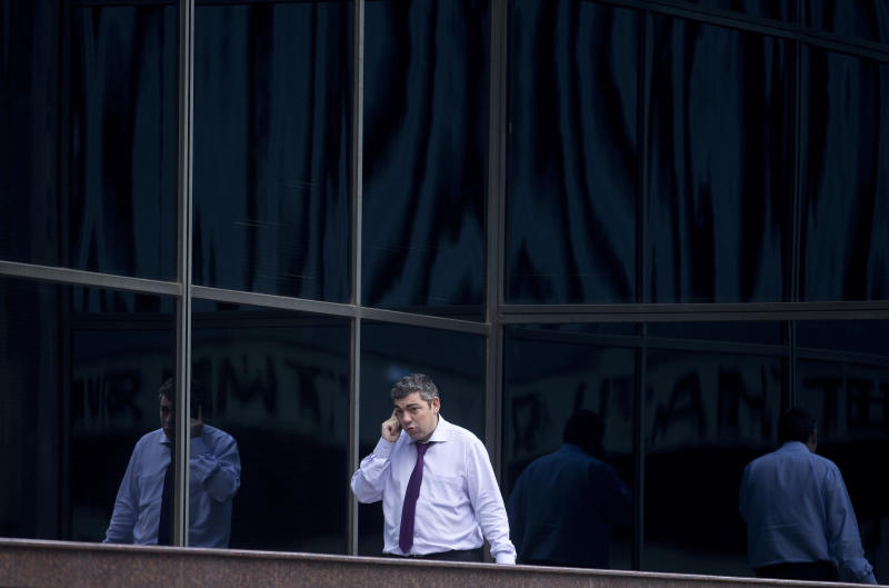FILE - In this Thursday, Jan. 17, 2013, file photo, a man speaks on a cell phone in the business district of Madrid. A Spanish newspaper published a document Monday, Oct. 28, 2013, that it said shows the U.S. National Security Agency spied on more than 60 million phone calls in Spain in one month alone — the latest revelation about alleged massive U.S. spying on allies. (AP Photo/Paul White, File)