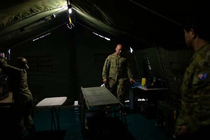 Members of a military support team prepare a field hospital at the town of Eden