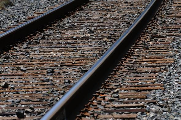 Drunk man sleeping on tracks escapes death after train runs over him