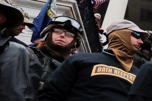 Members of the Oath Keepers militia group, including Jessica Marie Watkins, left, stand among supporters of President Donald Trump on the east front steps of the U.S. Capitol in Washington, Jan. 6, 2021. (Jim Bourg/Reuters)