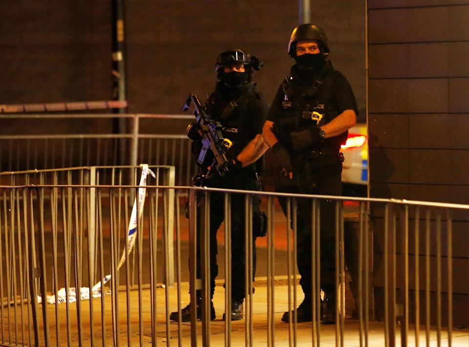 <p>Armed police officers stand next to a police cordon outside the Manchester Arena, where U.S. singer Ariana Grande had been performing, in Manchester, northern England, Britain, May 23, 2017. (Andrew Yates/Reuters) </p>