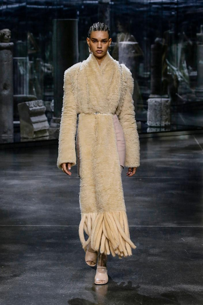 """<p>For Fendi, hairstylist Guido Palau braided several of the models' hair into <a href=""""https://www.allure.com/gallery/black-braided-hairstyles?mbid=synd_yahoo_rss"""" rel=""""nofollow noopener"""" target=""""_blank"""" data-ylk=""""slk:classic, sleek straight-back cornrows"""" class=""""link rapid-noclick-resp"""">classic, sleek straight-back cornrows</a> with their ends gathered into low buns. Others were given side parts. (They can't be dead if Palau is still doing them if you as us.) </p> <p>The brows were the center of makeup artist Peter Philips' contribution to the beauty look. He filled them in and brushed them up for timeless boldness to complement the models' glowing skin. </p>"""