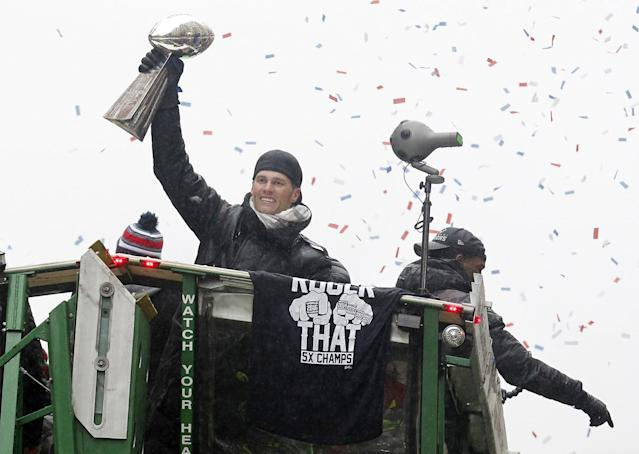 <p>New England Patriots quarterback Tom Brady hoists the Lombardi Trophy as he rides a duck boat during the Super Bowl LI parade. Mandatory Credit: Stew Milne-USA TODAY Sports </p>