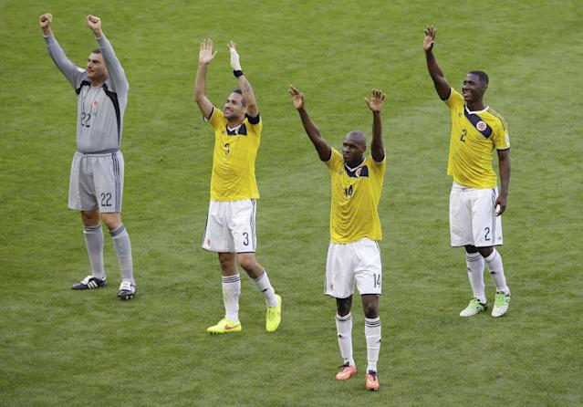 Colombia's goalkeeper Faryd Mondragon (22), Mario Yepes (3), Victor Ibarbo (14), and Cristian Zapata (2) salute fans after the group C World Cup soccer match between Colombia and Greece at the Mineirao Stadium in Belo Horizonte, Brazil, Saturday, June 14, 2014. Colombia won the match 3-0. (AP Photo/Andrew Medichini)
