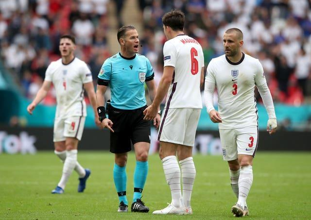 Harry Maguire talks to the referee