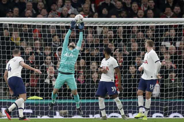 Tottenham's goalkeeper Hugo Lloris leaps for a save during the English FA Cup fourth round replay soccer match between Tottenham Hotspur and Southampton at the Tottenham Hotspur Stadium in London, Wednesday, Feb. 5, 2020. (AP Photo/Kirsty Wigglesworth)