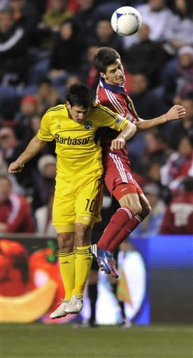 Chicago Fire's Alvaro Fernandez right, goes up for a header against Columbus Crew's Milovan Mirosevic during the first half of an MLS soccer match against the Columbus Crew in Bridgeview, Ill., Saturday, Sept. 22, 2012. (AP Photo/Paul Beaty)