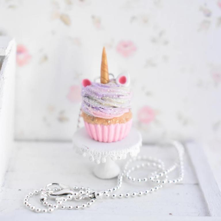 """<p><strong>Decadent Mini</strong></p><p>decadentmini.com</p><p><strong>$25.00</strong></p><p><a href=""""https://www.decadentmini.com/collections/necklaces/products/scented-unicorn-cupcake-necklace"""" rel=""""nofollow noopener"""" target=""""_blank"""" data-ylk=""""slk:SHOP NOW"""" class=""""link rapid-noclick-resp"""">SHOP NOW</a></p><p>Now she can wear her favorite treat as a necklace! This necklace is <strong>scented like a real cupcake</strong>, so it'll keep her in a good mood all day long. It also comes in purple. <em>Ages 10+</em></p>"""