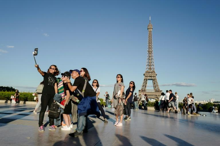 Selfie spots have become part of the tourism industry, with some tour organisers promising the best locations to snap yourself (AFP Photo/Ludovic MARIN)