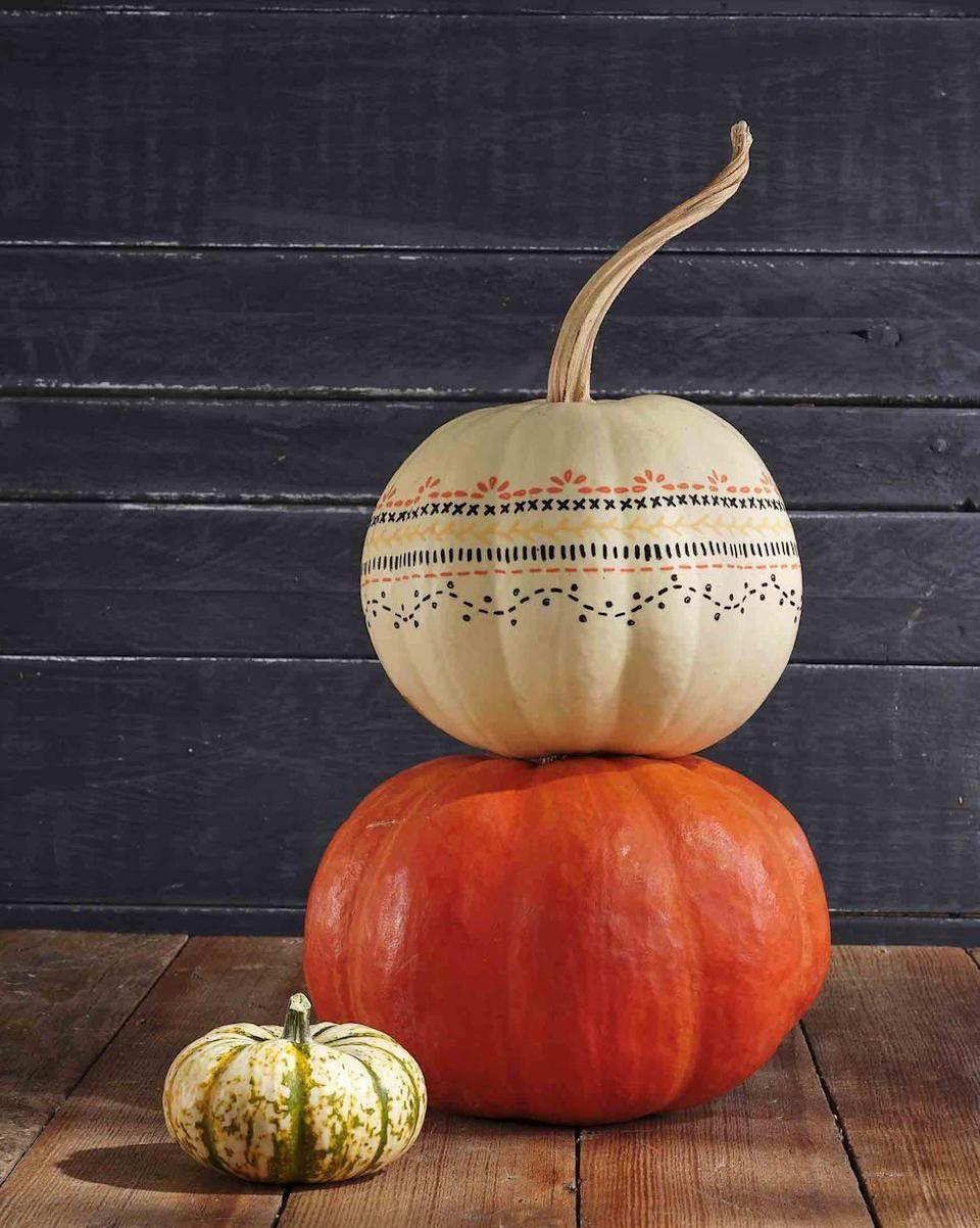 <p>A totally easy way to bring charm to your porch, all you have to do is stencil any design you want (or copy this one!), and use black, orange and yellow paint pens to cover drawing.</p>