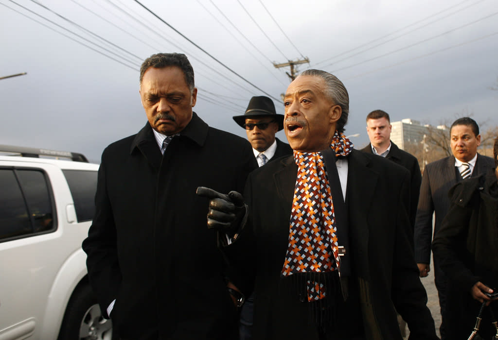 """Reverend Jesse Jackson and Reverend Al Sharpton were spotted chatting after the funeral. Before the service began, Sharpton tweeted about the fact that Brown was not being allowed to sit front row alongside his daughter Bobbi Kristina. """"I am at Whitney's funeral. I spoke with Bobby Brown trying to calm him down and not distract from the services. Today is about Whitney!"""" (2/18/2012)"""