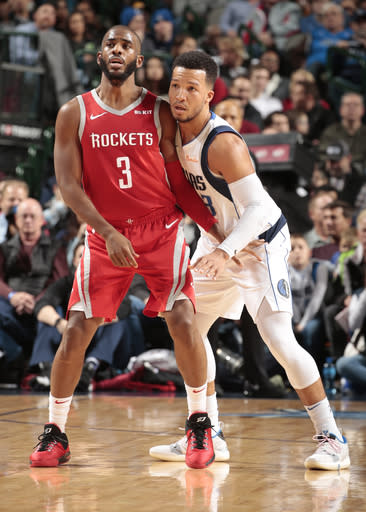 DALLAS, TX - DECEMBER 8: Chris Paul #3 of the Houston Rockets fights for position against the Dallas Mavericks on December 8, 2018 at the American Airlines Center in Dallas, Texas. (Photo by Glenn James/NBAE via Getty Images)