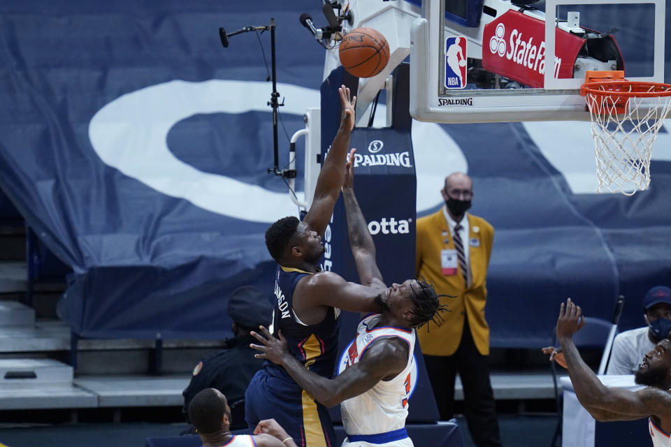 New Orleans Pelicans forward Zion Williamson shoots against New York Knicks forward Julius Randle (30) in the first half of an NBA basketball game in New Orleans, Wednesday, April 14, 2021. (AP Photo/Gerald Herbert)