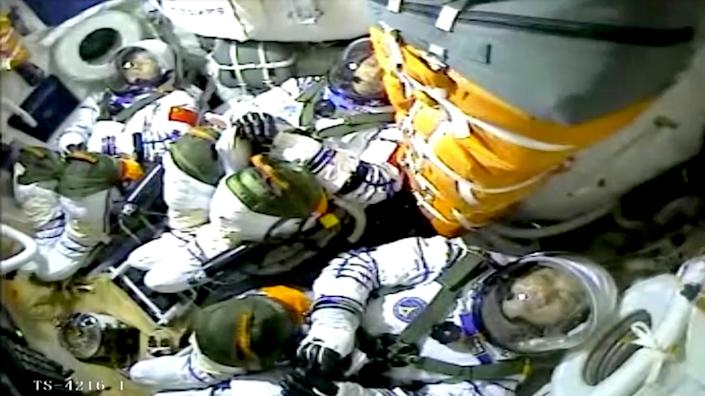 Chinese astronauts Nie Haisheng, Liu Boming, and Tang Hongbo are seen inside the Shenzhou-12 spacecraft (Reuters)