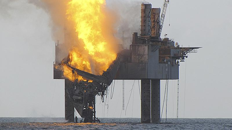 In this Wednesday, July 24, 2013 photo released by the U.S. Coast Guard, abatement efforts underway near Hercules 265 Rig where fire has caused collapse of the drill floor and derrick following an explosion Tuesday night. An out-of-control natural gas well burned Wednesday off Louisiana hours after it ignited following a blowout, though authorities said there was no sign of a slick on the surface of the water. (AP Photo/U.S. Coast Guard)