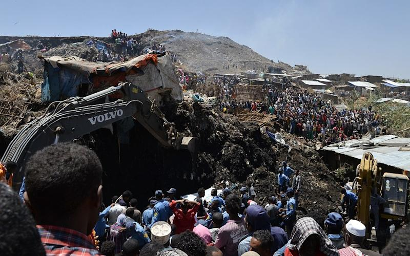 Local residents gather at the site where a massive rubbish landslide occurred at the outskirts of Ethiopia's capital Addis Ababa - Xinhua / Barcroft Media