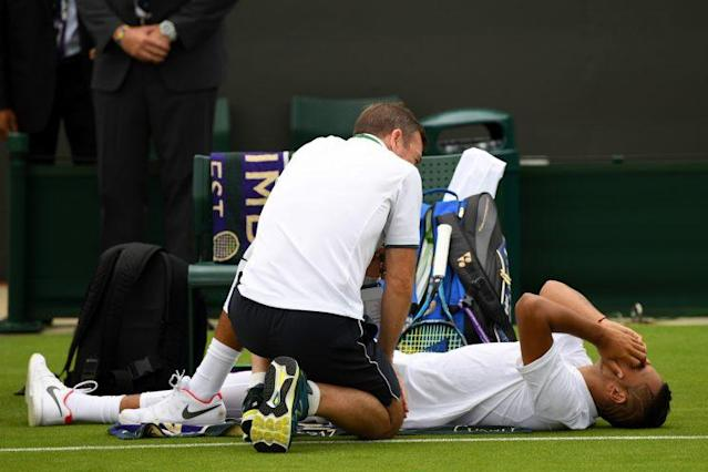 Nick Kyrgios was forced to retire in his first round match of Wimbledon due to a nagging hip injury. (Getty Images)