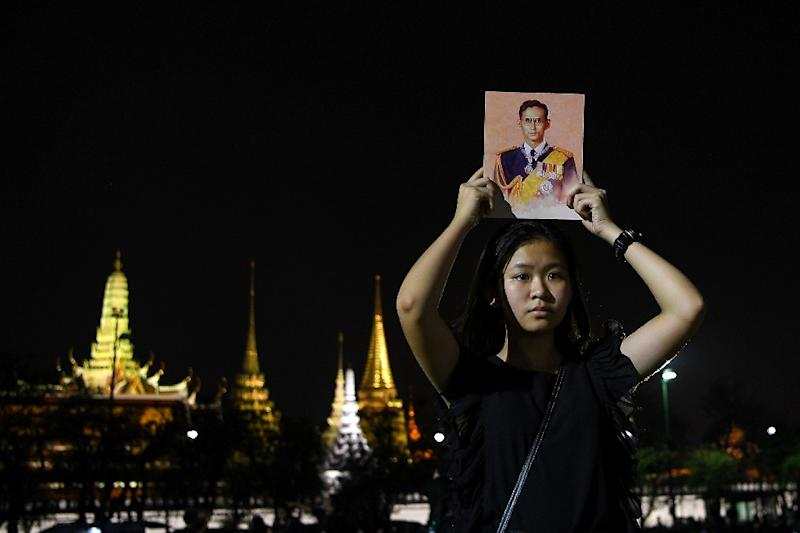 Most in the distraught nation have honoured the late King Bhumibol Adulyadej in black (AFP Photo/Manan Vatsyayana)