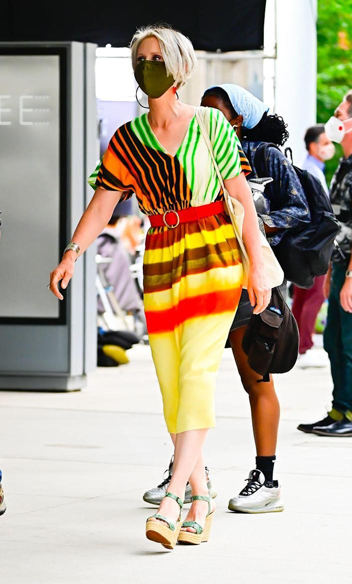 """<p>In a more colorful and exciting ensemble, Nixon wore a <a href=""""https://www.instagram.com/p/CRSPiDMDTV2/"""" rel=""""nofollow noopener"""" target=""""_blank"""" data-ylk=""""slk:Dries Van Noten"""" class=""""link rapid-noclick-resp"""">Dries Van Noten </a>Dorias drawstring tie-dyed striped faille midi dress along with Clergerie's leather animal-print wedges, and carried Loewe's Balloon bag. </p>"""