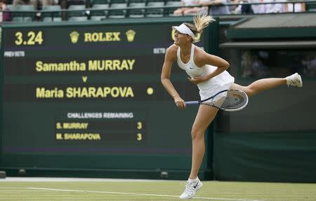 Maria Sharapova of Russia serves to Samantha Murray of Britain in their women's singles tennis match at the Wimbledon Tennis Championships, in London June 24, 2014. REUTERS/Stefan Wermuth