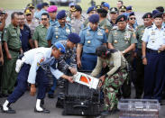The flight data recorder of AirAsia QZ8501 is transferred to another container at the airbase in Pangkalan Bun, Central Kalimantan January 12, 2015. REUTERS/Darren Whiteside
