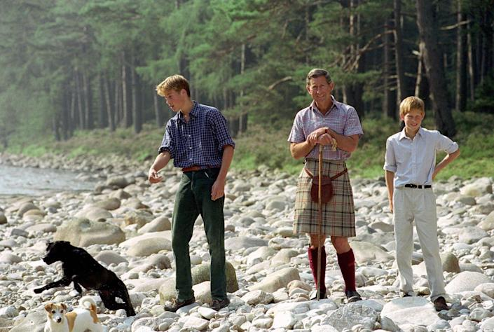 <p>Prince William, Prince Charles, and Prince Harry out for a walk at their Balmoral Estate in 1997.</p>