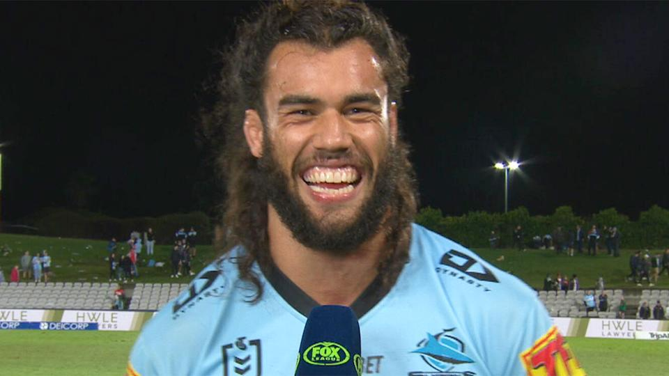 Pictured here, Cronulla star Toby Rudolf partakes in a post-match interview on Fox Sports.