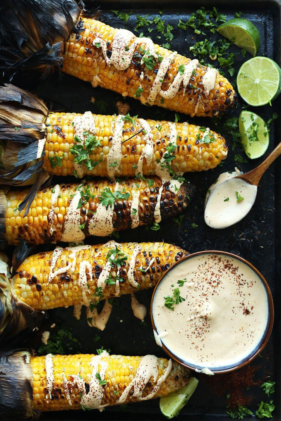 """<p>Drizzle charred corn on the cob with lime juice, sriracha aioli, and fresh herbs for a low effort, flavor-packed side. </p><p><a href=""""https://minimalistbaker.com/grilled-corn-sriracha-aioli/"""" rel=""""nofollow noopener"""" target=""""_blank"""" data-ylk=""""slk:Get the recipe."""" class=""""link rapid-noclick-resp"""">Get the recipe. </a></p>"""
