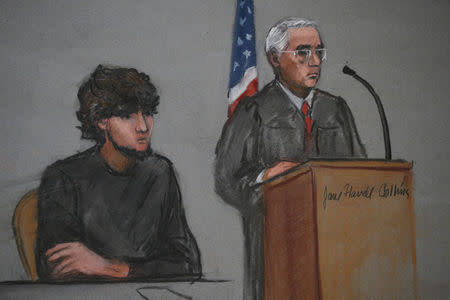 Accused Boston Marathon bomber Dzhokhar Tsarnaev is shown in a courtroom sketch next to Judge George O'Toole on the first day of jury selection at the federal courthouse in Boston