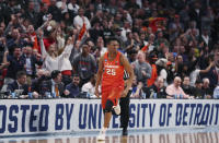 Syracuse guard Tyus Battle (25) heads to the other end after a 3-point basket during the closing minutes of a second-round game against Michigan State in the NCAA men's college basketball tournament Sunday, March 18, 2018, in Detroit. (AP Photo/Carlos Osorio)